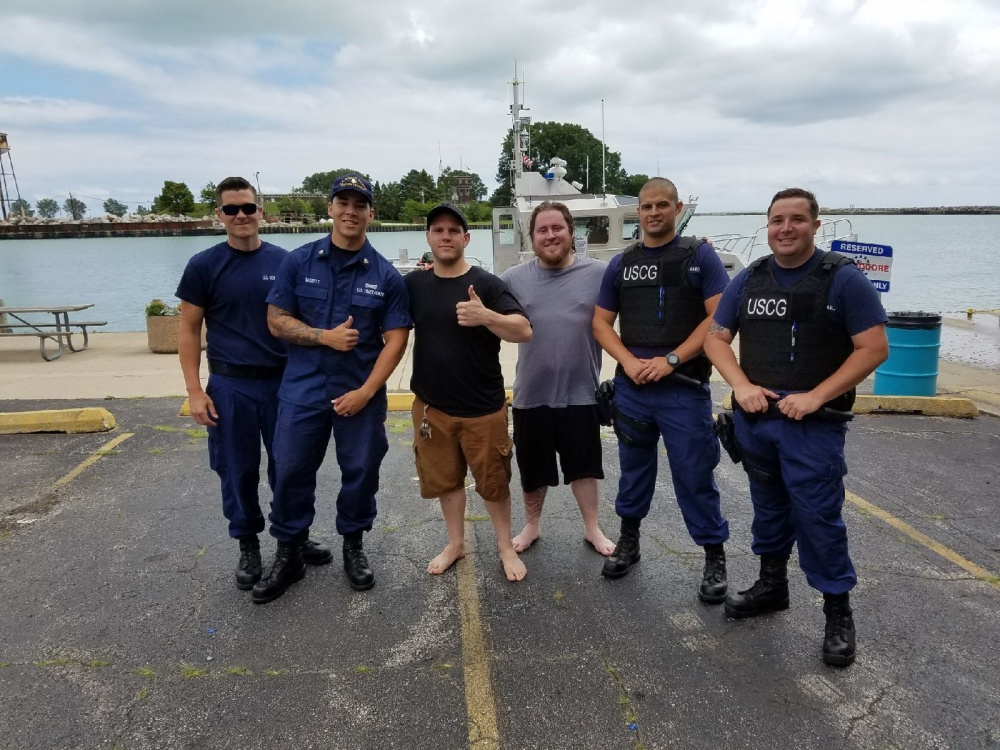 image of rescue team and fishermen