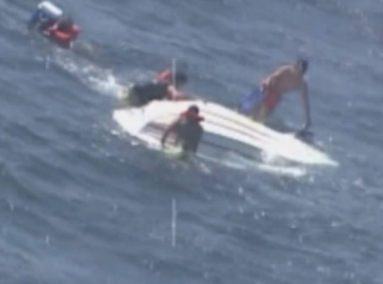 image of boaters being rescued
