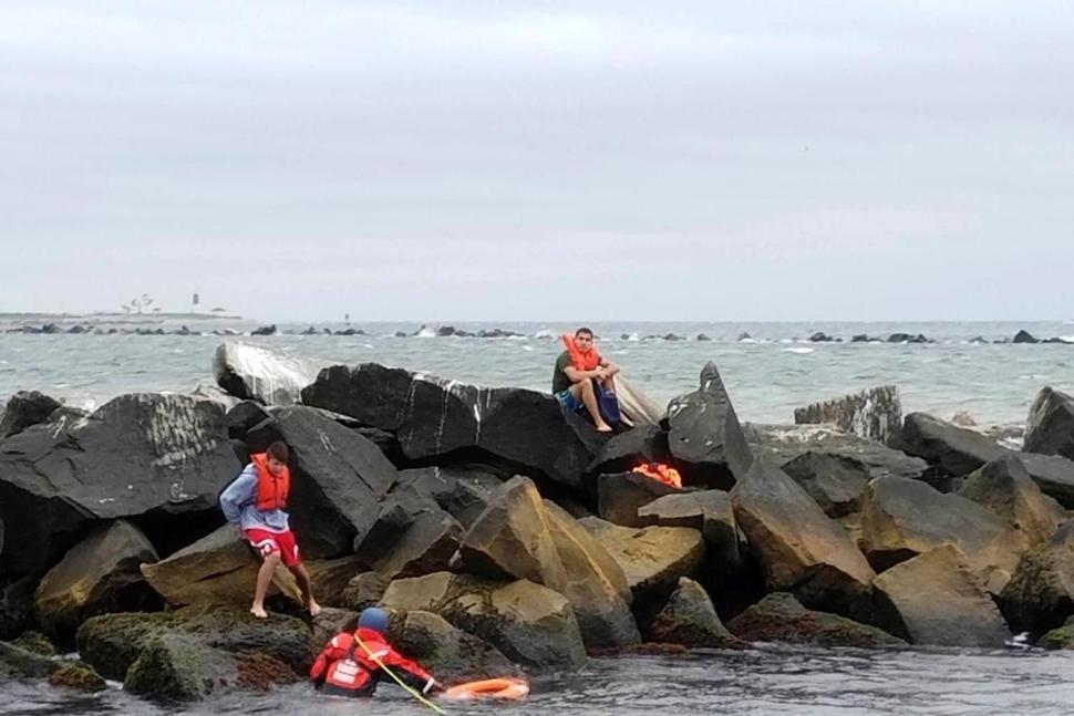 Image of teenagers on rocks